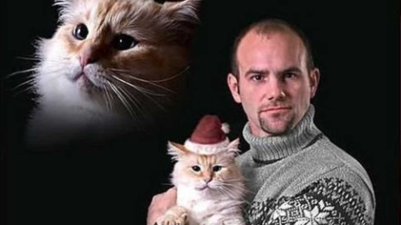 what we have in front of us is a man that is dedicated to his feline companion so dedicated that he needed herhim in his christmas photo - Awkward Family Christmas Photos